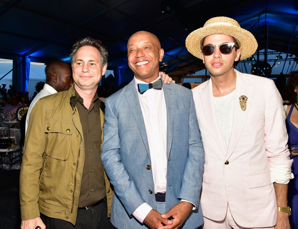 BRIDGEHAMPTON, NY - JULY 16:  Jason Binn, Russell Simmons and DJ Cassidy attend Rush Philanthropic Arts Foundation's 2016 ART FOR LIFE Benefit presented by Bombay Sapphire Gin at Fairview Farms on July 16, 2016 in Bridgehampton, New York.  (Photo by Eugene Gologursky/Getty Images for Bombay Sapphire)