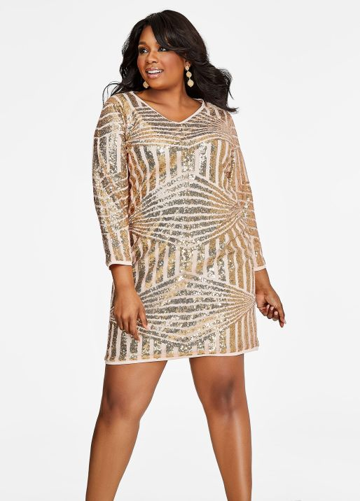 The plus-size Geo Sequin Pattern Dress from Ashley Stewart. Get your rock and roll on, diva queen! This stylish and stunning plus size dress comes with a fun geo print that's unique and trendy, a shiny sequin pattern that'll have you be the life of the party, and a killer fit to show off your curves, confidence, and charisma. Available at www.ashleystewart.com for $39.75