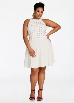 The plus-size Gold Studded Top Sleeveless Dress from Ashley Stewart. Glam it up with my plus size skater dress that comes sleeveless and sexy! This easy-to-wear, knee-length, fit-and-flare dress will accentuate your gorgeous curves and have you feeling ready to party, especially with my gold studded design on top that's cool, sleek, and undeniably stylish. Available from www.ashleystewart.com for $32.25