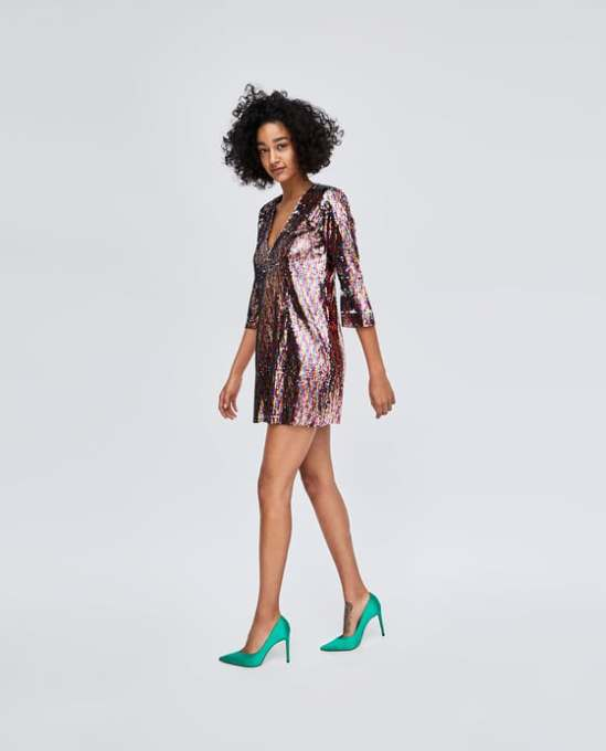 The Multicolored Sequin Dress from Zara. Short V-neck dress with 3/4 sleeves, shoulder pads and multicolored, sequinned fabric. Available at www.zara.com for $69.90