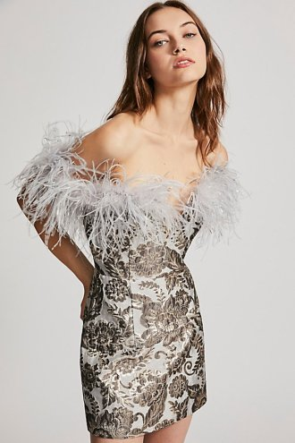 Pop Goes The Party Dress from Free People. This stunning strapless mini dress has a shimmering jacquard design and features a front deep V and removable feather accent. Available from www.FreePeople.com for $490