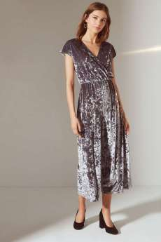 Urban Outfitters Isabella Velvet Surplice Jumpsuit. Jump headfirst into this is velvet jumpsuit from Urban Outfitters. Made from a crushed velvet fabrication in a wrap construction topped with a surplice style plunging v-neckline. Topped with short capped sleeves. Finished with a wide-cut, cropped leg pant bottom. Available from www.urbanoutfitters.com for $79