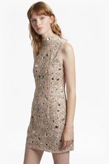 The Eloise Sleeveless Dress from French Connection. Amp up your party wear with head-to-toe sparkle in the Eloise Sleeveless Dress. Hand-embellished all over in intricate sequins and mirrors rimmed in gold lurex thread, the sparkle of this delicate pink dress is punctuated by a sheer mesh back. With a mock neck and form-fitting shape, the mini dress cuts a classic, clean silhouette which allows the embellishment to shine. Wear with a gold heel and matching clutch bag to sparkle throughout the festive period. Available at www.usa.frenchconnection.com for $348