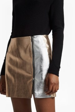 The Audrey Faux Leather Mini Skirt from French Connections is a statement alternative to your loyal leather skirt. Crafted in two-tone metallic faux leather, this design has an exposed side zip and mini length. Your ultimate day to night skirt, swap a roll neck jumper for a silky cami and trainers for heels to take it out after dark. Read more at https://usa.frenchconnection.com for $64.99