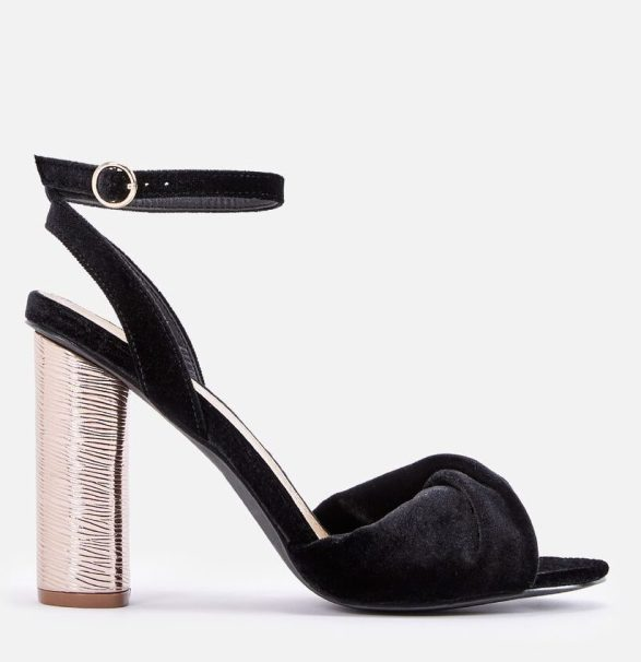 Alexandrine heel from Just Fab. Hit the holiday party in style with these cylinder heels featuring a dainty ankle strap closure and twist vamp detail. Available at www.JustFab.com for $59.95