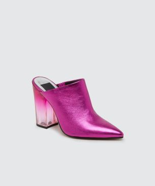 Enya Mules from Dolce Vita. A modern, pointed mule silhouette in must-have bight colored metallic hue, ENYA instantly elevates any outfit. Available from www.dolcevita.com for $112.90