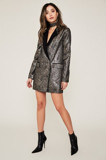 AFRM's Morrison Tuxedo Blazer. For a fancy dress code, the Morrison Blazer has a metallic snake print, longline silhouette, and contrast lapels. Very chic, very sexy. Available at www.shopAFRM.com for $108