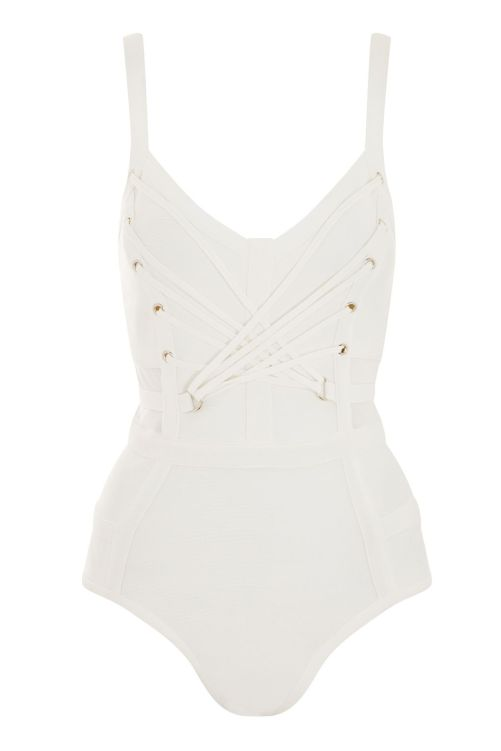 The Corset Bandage Bodysuit from TopShop. We're loving this white strappy body with bandage material and corseting at the waist. Team with wide leg stripe pants for a contemporary update. Available at www.us.topshop.com for $125