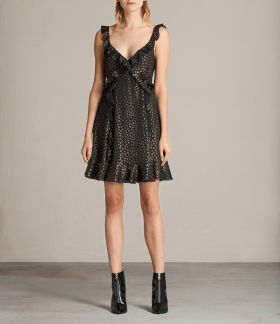The sleeveless Darell Ruffle Dress from All Saints in a sheer metallic print features laser cut ruffles along the straps and the full skirt. Available from www.us.allsaints.com for $308