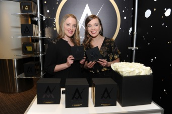 Kara Lindsay (L) and Abby Mueller attend the GRAMMY Gift Lounge during the 60th Annual GRAMMY Awards at Madison Square Garden