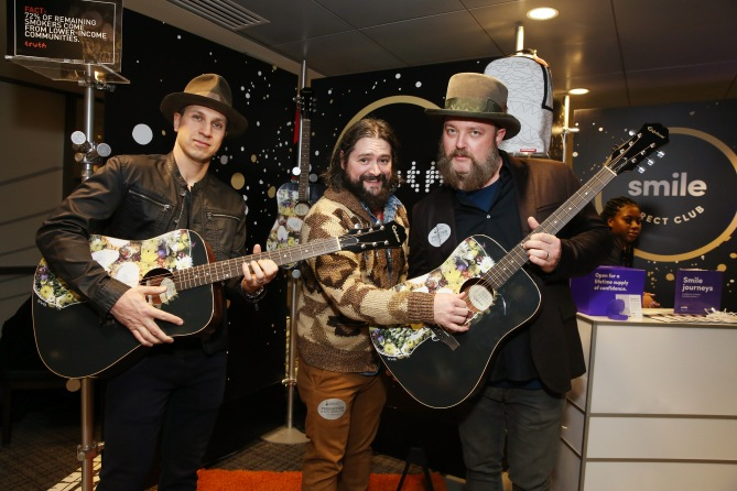 (L-R) Musicians Jimmy De Martini, Clay Cook and John Driskell Hopkins of musical group Zac Brown Band attend the GRAMMY Gift Lounge during the 60th Annual GRAMMY Awards at Madison Square Garden