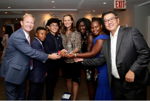 Dan Faber, Pam Shriver, former pro tennis player and past president of the USTA Foundation, and Tom Chen with participants in the Foundation's National Junior Tennis League
