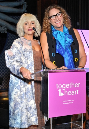 L-R: Actress Jenn Lyon and comedienne Judy Gold conduct the live auction at the Together1Heart Foundation Gala at TAO Downtown in New York, NY on October 1, 2018. (Photo by Stephen Smith/Guest of a Guest)