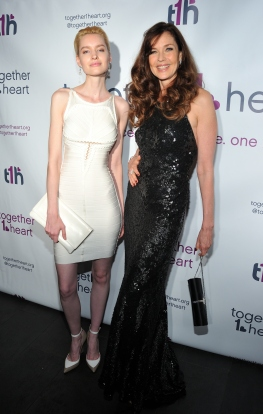 L-R: Models Snow Dollkinson and Carol Alt attend the Together1Heart Foundation Gala at TAO Downtown in New York, NY on October 1, 2018. (Photo by Stephen Smith/Guest of a Guest)