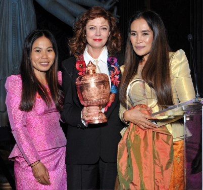 Sina Vann (L) and Somaly Mam (R) present the award to actress Susan Sarandon (C) at the Together1Heart Foundation Gala at TAO Downtown in New York, NY on October 1, 2018. (Photo by Stephen Smith/Guest of a Guest)