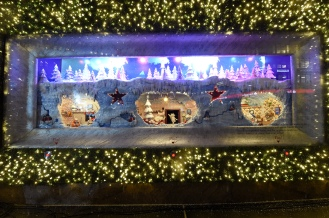 """Macy's Herald Square unveils its legendary Christmas windows celebrating the theme """"Believe In The Wonder Of Giving,"""" Thursday, Nov. 15, 2018, in New York. The six enchanted windows share a tale of friendship, family, adventure, and teamwork as Sunny the Snowpal works to save Christmas with the help of her friends. (Diane Bondareff/AP Images for Macy's)"""