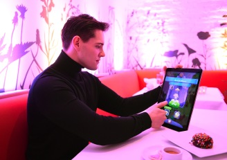 "NEW YORK, NY - FEBRUARY 06: Riverdale's Casey Cott plays the new Valentine's Day update in Candy Crush Friends Saga during the ""Sweet n Solo"" Singles Dining Experience at Dirt Candy on February 6, 2019 in New York City. (Photo by Ilya S. Savenok/Getty Images for King Games)"