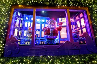 """Macy's Herald Square unveils its iconic holiday windows celebrating the theme """"Believe in the Wonder,"""" Thursday, Nov. 21, 2019, in New York. The six magical windows take spectators on a journey with Santa Girl as she embraces the spirit of the holidays. (Diane Bondareff/AP Images for Macy's)"""
