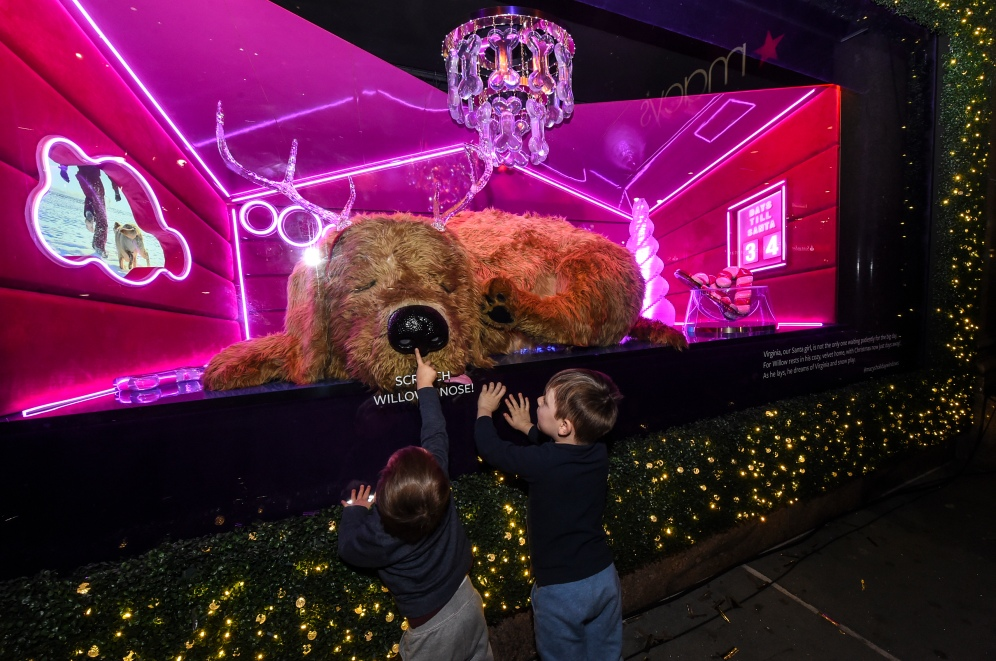 "Macy's Herald Square unveils its iconic holiday windows celebrating the theme ""Believe in the Wonder,"" Thursday, Nov. 21, 2019, in New York. The six magical windows take spectators on a journey with Santa Girl as she embraces the spirit of the holidays. (Diane Bondareff/AP Images for Macy's)"